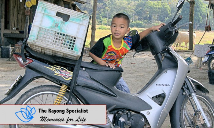 Motor cycle and a boy in Rayong